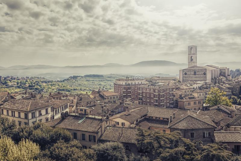 Perugia in a misty cloud and fog, an artistic vision elaborated at the computer of the city center stock image
