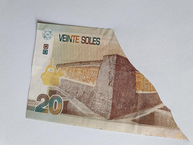 Peruvian banknote of twenty soles on the broken sheet of paper. Commerce, exchange, trade, trading, value, buy, sell, profit, price, rate, cash, currency royalty free stock photos