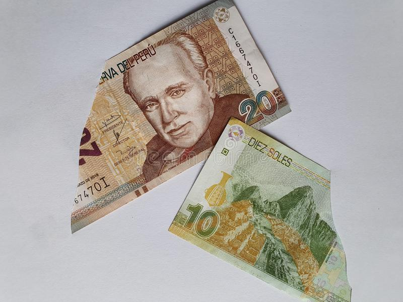 Peruvian banknotes of different denominations on the broken sheet of paper. Commerce, exchange, trade, trading, value, buy, sell, profit, price, rate, cash stock image