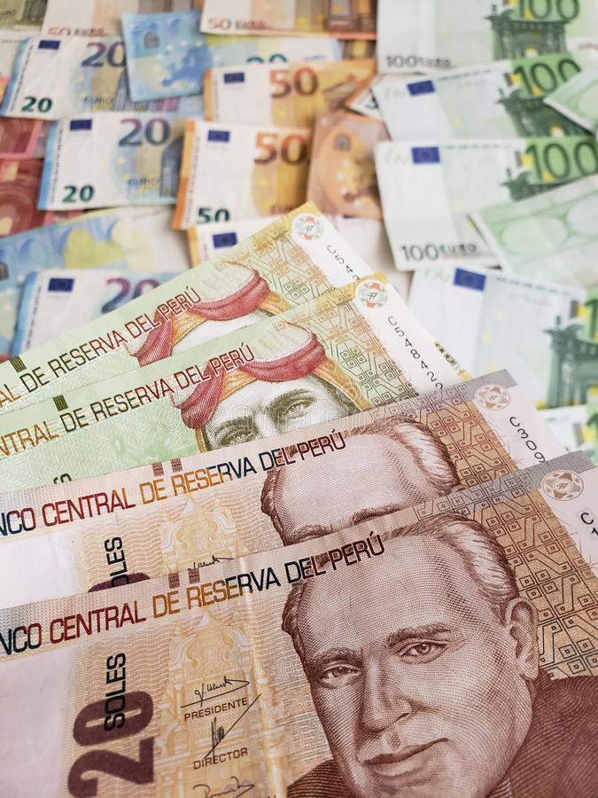 Peruvian banknotes and euro bills of different denominations. European bills of different denominations, background, commerce, exchange, trade, trading, value royalty free stock image