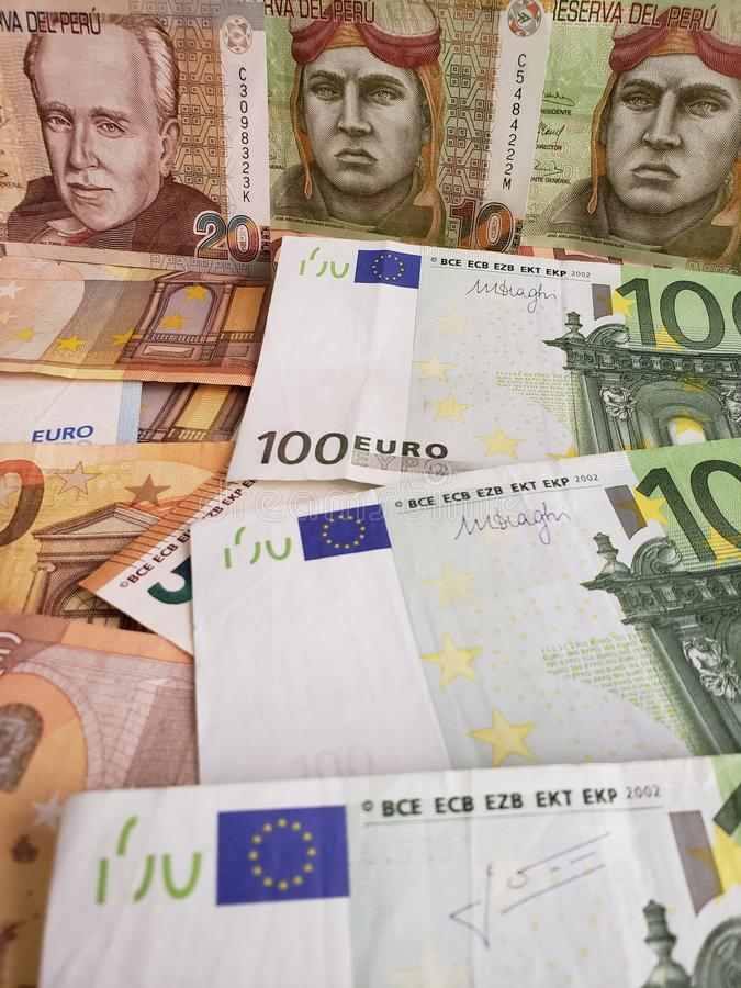 Peruvian banknotes and euro bills of different denominations. European bills of different denominations, background, commerce, exchange, trade, trading, value royalty free stock photos