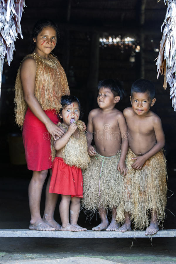 Peruvian children in traditional dress in an Amazon village in Peru stock photos