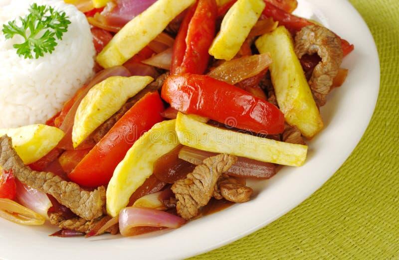Peruvian Dish Called Lomo Saltado stock photos