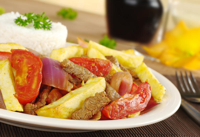 Peruvian Dish Called Lomo Saltado royalty free stock photography