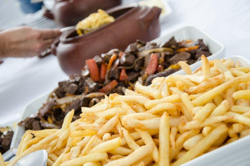 Peruvian dish Lomo saltado stock photography