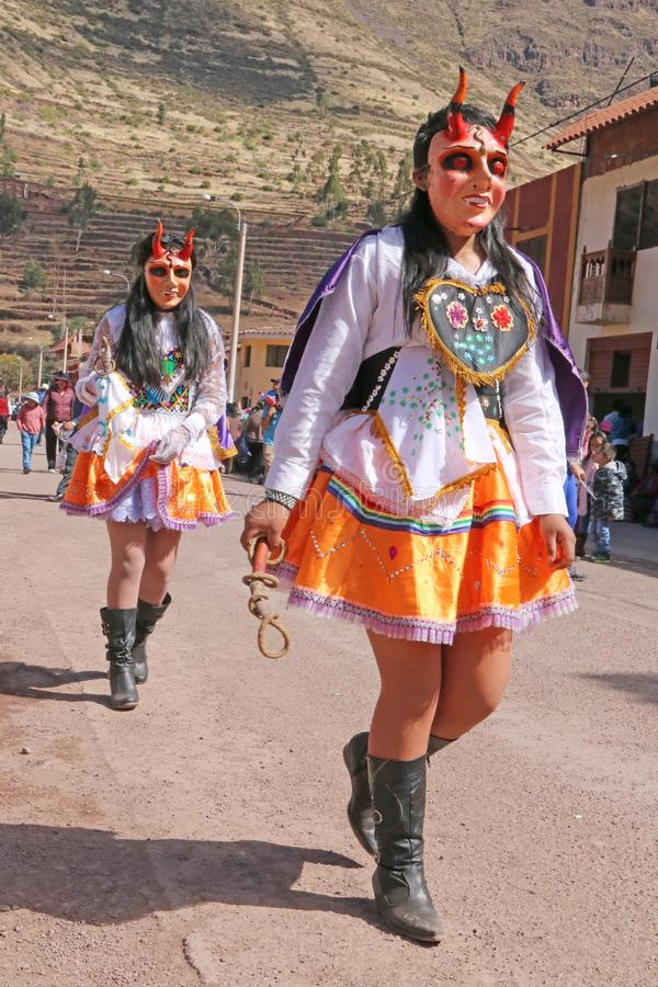 Peruvian fiesta. Masked dancers at a traditional Peruvian fiesta, celebrating the Virgen of Carmen in Pisac, in the Sacred Valley near Cusco stock photography