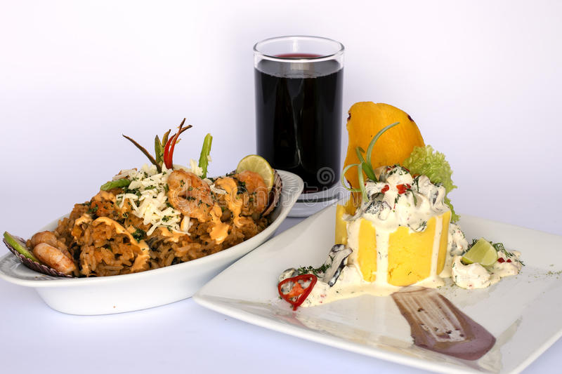 Peruvian Food: Causa Rellena, A smashed popatoes filled with crab meal and Rice with sea food. 2 dishes served as a main meal. stock photos