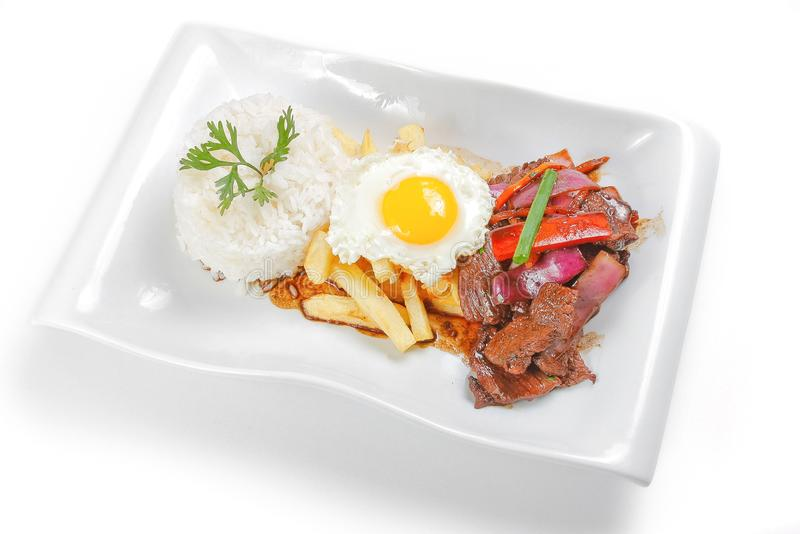 Peruvian food or lomo saltado with rice and fried egg royalty free stock photos