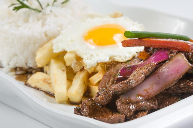 Peruvian food or lomo saltado with rice and fried egg stock images
