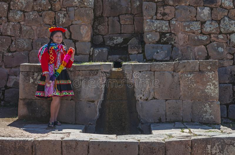 Peruvian Indigenous Woman by a Fountain, Cusco stock photos