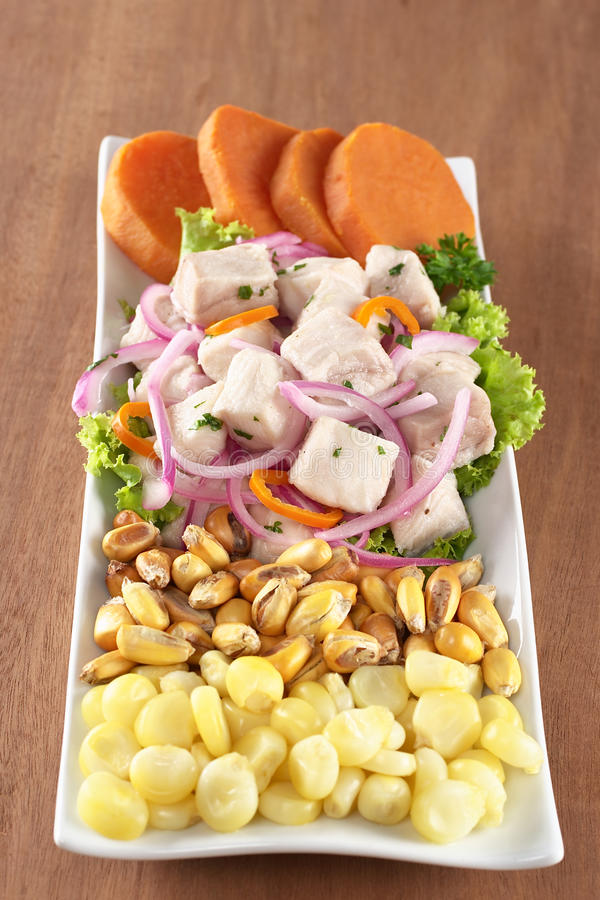 Peruvian-Style Ceviche. Made out of raw dogfish (Spanish: tollo), red onions and aji (Peruvian hot pepper) and served with corn, roasted corn (cancha) and stock photos