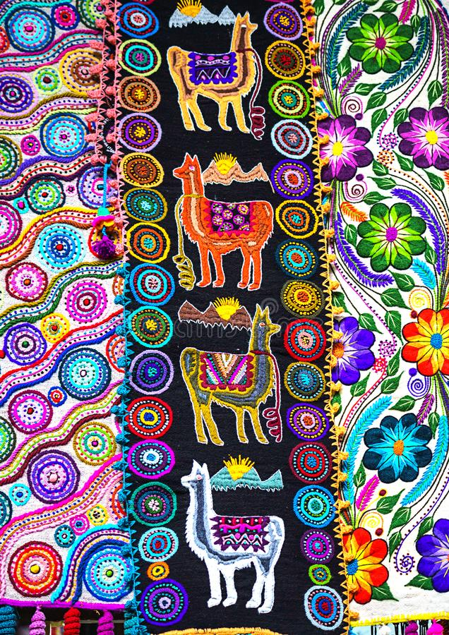 Peruvian traditional colourful native handicraft textile fabric with llama pattern at market in Peru, South Americain. Close up. Selective focus stock image