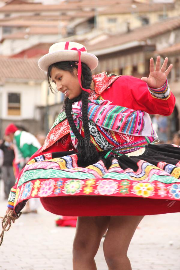 A Peruvian Woman at a festival. A Peruvian Woman in traditional clothing is dancing at a festival in the city of Cuzco, Peru royalty free stock photography