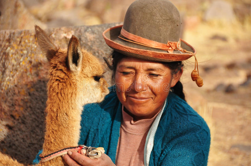 Peruvian Woman with her vicugna royalty free stock photography