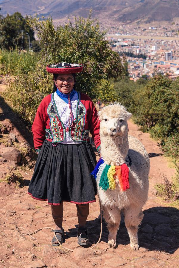 Peruvian Woman with Lama in Cusco royalty free stock images