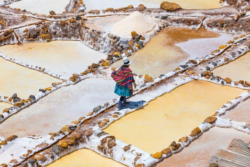 Peruvian woman in the saltpans of Moray Peru stock photo