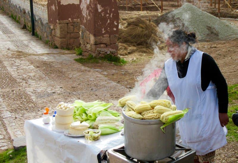 Peruvian woman selling corn royalty free stock image