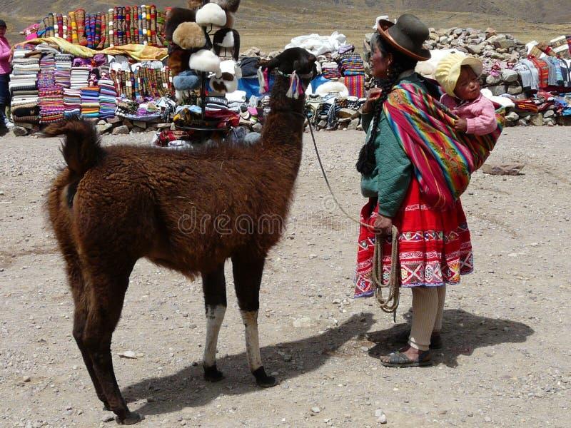 Peruvian woman in traditional clothing on the pass of Abra la Raya, Peru stock photography