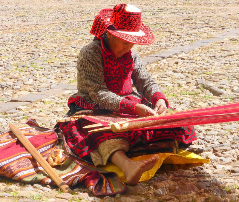 Peruvian woman and weaving loom stock images
