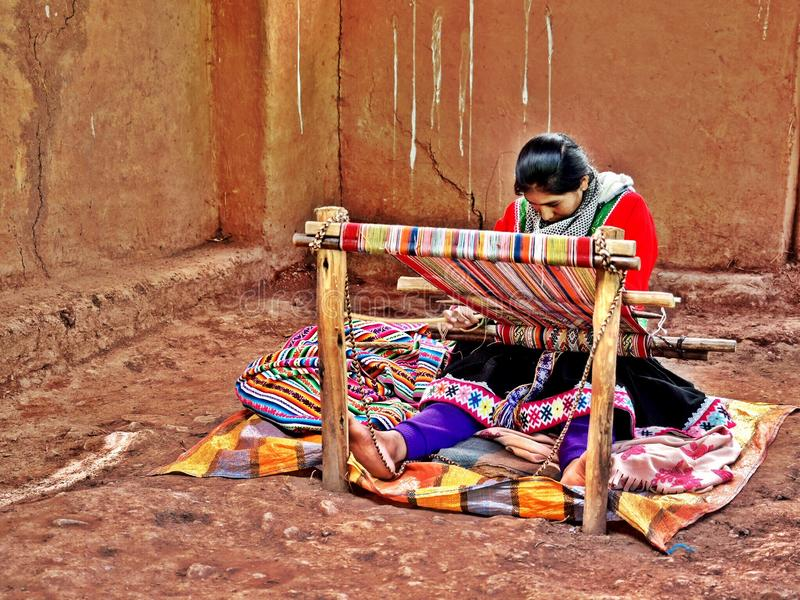 Peruvian Woman Weaving on Traditional Loom royalty free stock images
