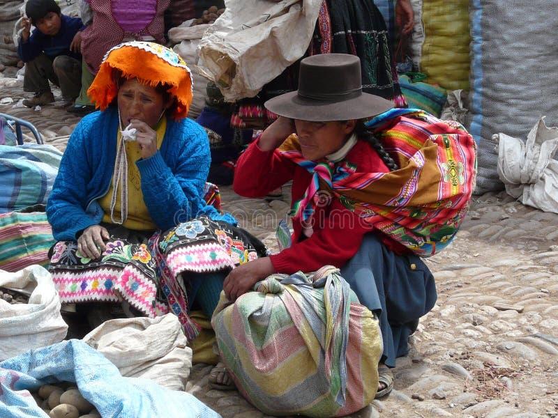 Peruvian women in the market of Pisac, Peru royalty free stock images