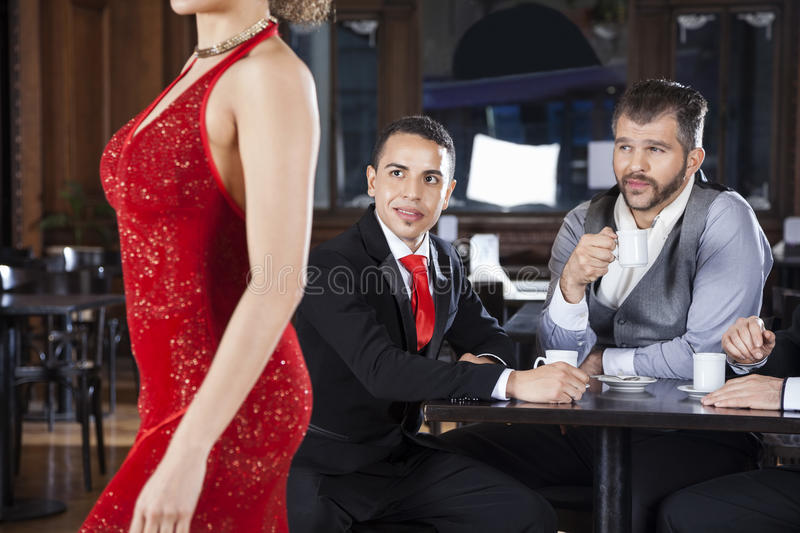 Pervert Customers Looking At Tango Dancer In Cafe. Pervert male customers looking at female tango dancer walking in cafe stock images