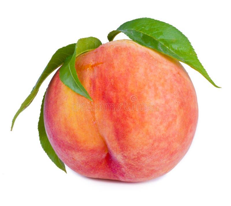 Perzikfruit met bladeren stock afbeelding