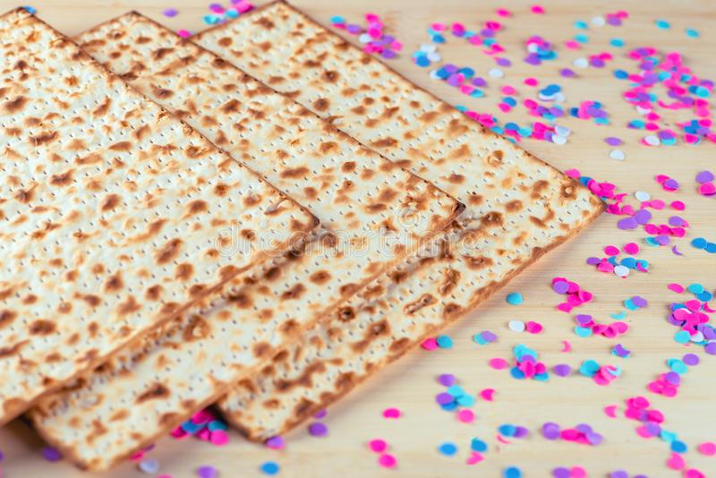 Pesach celebration concept. Matzah and confetti happy colorful background for Jewish Passover holiday. stock image