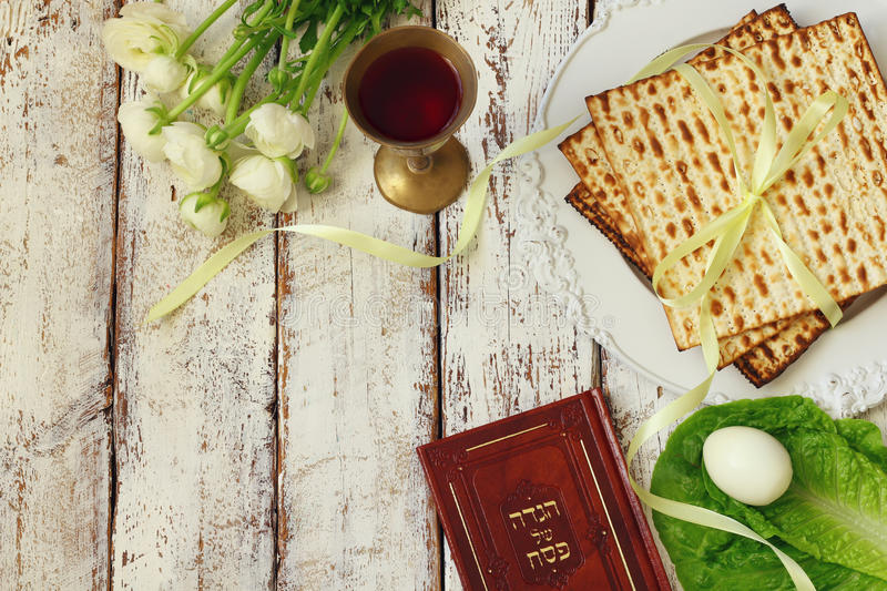 Pesah celebration concept & x28;jewish Passover holiday& x29;. Traditional book with text in hebrew: Passover Haggadah & x28;Passover Tale& x29 stock images
