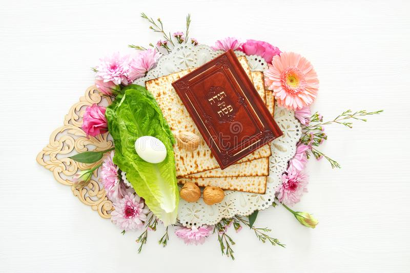 Pesah celebration & x28;jewish Passover& x29;. Traditional book with text in hebrew: Passover Haggadah & x28;Passover Tale& x29;. Pesah celebration concept & stock images