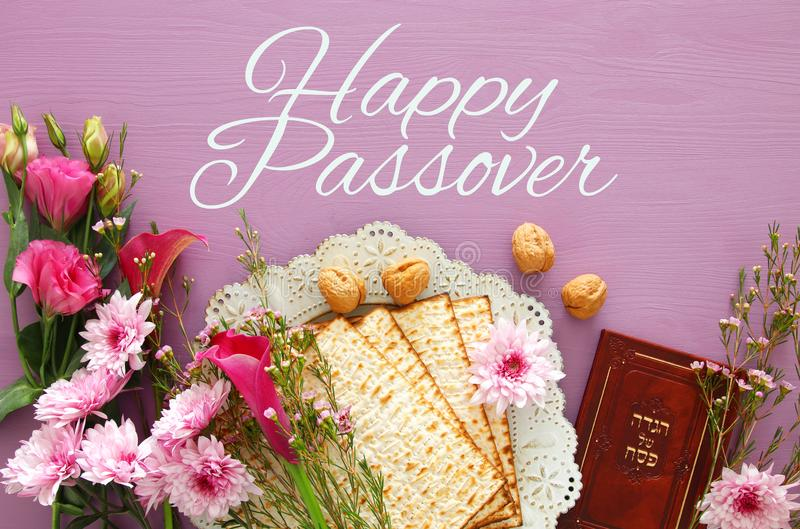 Pesah celebration & x28;jewish Passover& x29;. Traditional book with text in hebrew: Passover Haggadah & x28;Passover Tale& x29;. Pesah celebration concept & royalty free stock photography