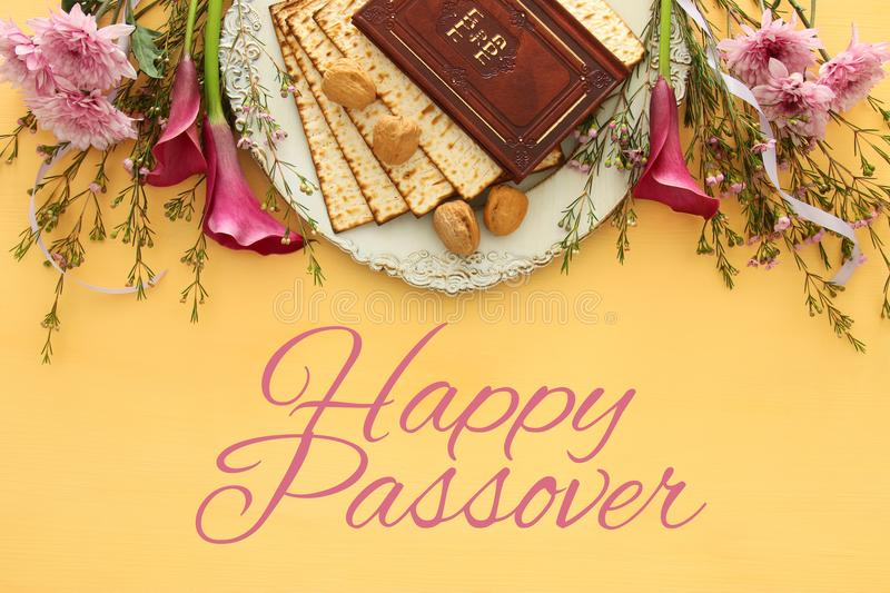 Pesah celebration & x28;jewish Passover& x29;. Traditional book with text in hebrew: Passover Haggadah & x28;Passover Tale& x29;. Pesah celebration concept & stock image