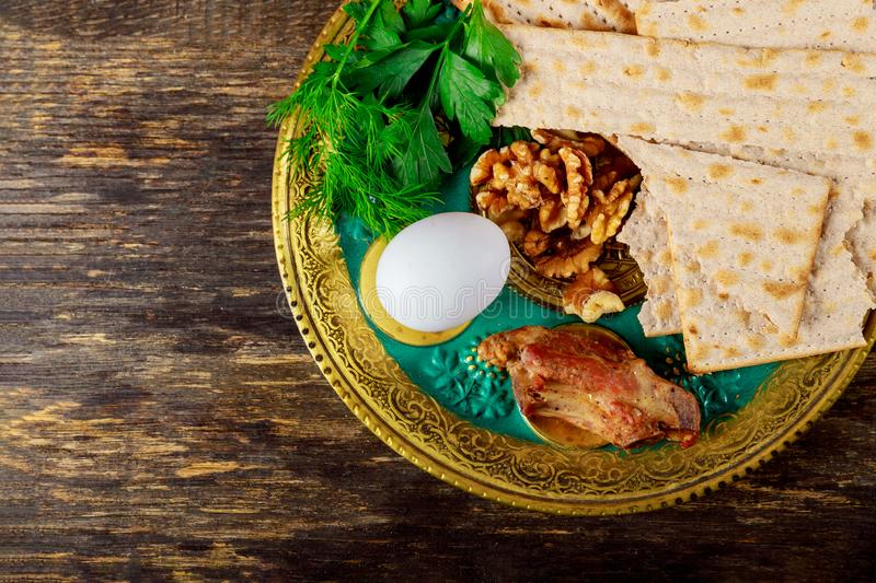 Pesah concept jewish Passover holiday. Traditional pesah seder plate with celery, egg, bone, maror, charoset Passover Haggadah. Pesah concept jewish holiday royalty free stock images