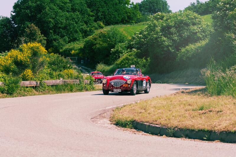 AUSTIN HEALEY 100/4 BN2 1956 on an old racing car in rally Mille Miglia 2018 the famous italian historical race 1927-1957. PESARO COLLE SAN BARTOLO , ITALY - MAY royalty free stock images