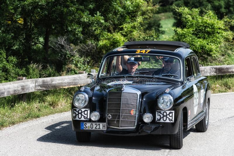 MERCEDES-BENZ 220 A 1955. PESARO COLLE SAN BARTOLO , ITALY - MAY 17 - 2018 : MERCEDES-BENZ 220 A 1955 on an old racing car in rally Mille Miglia 2018 the famous stock photos