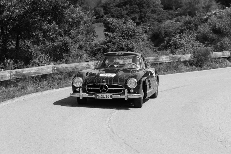 MERCEDES-BENZ 300 SL COUPÉ W198 1956 on an old racing car in rally Mille Miglia 2018 the famous italian historical race 1927-19. PESARO COLLE SAN BARTOLO stock photography