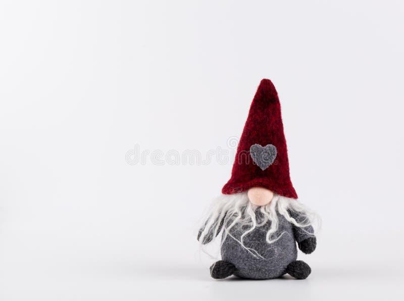 Pesca à corrica, Santa, Red Hat longo com coração , decoração escandinava feito a mão do Natal imagem de stock