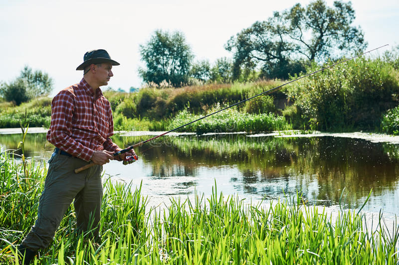 Pesca de Fisher com haste de giro fotos de stock royalty free