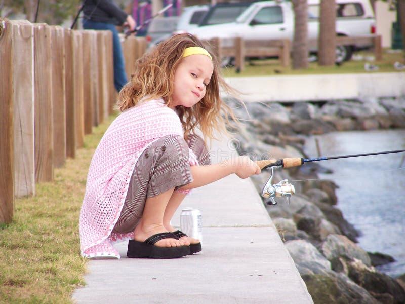 Pesca de la niña imagen de archivo libre de regalías
