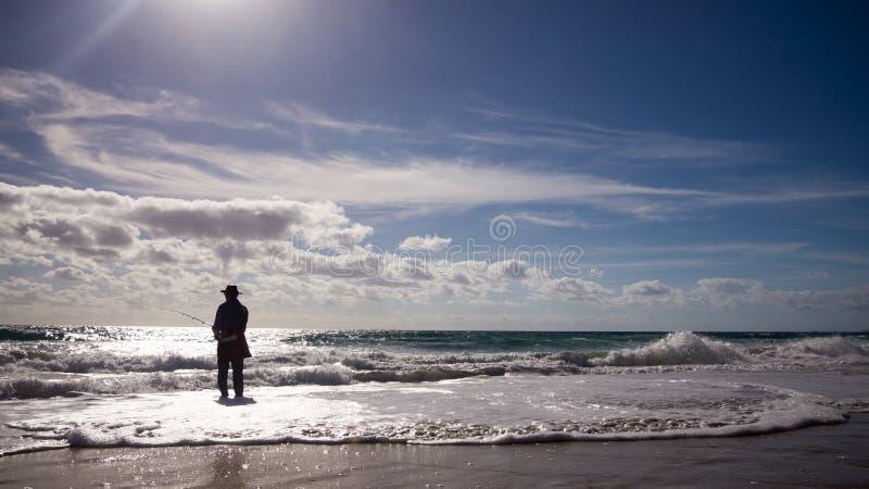 Pesca de la playa imagen de archivo libre de regalías