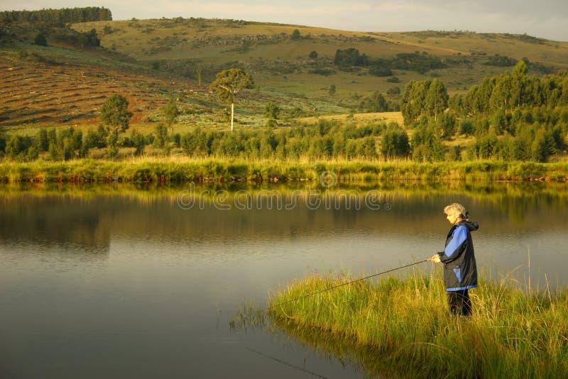 Pesca de lago lady foto de archivo libre de regalías