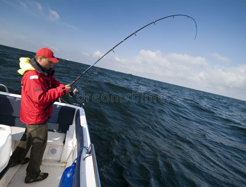 Pesca de mar do barco foto de stock
