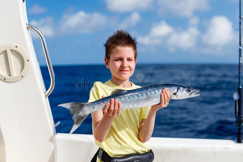 Pesca de mar profundo do menino fotografia de stock