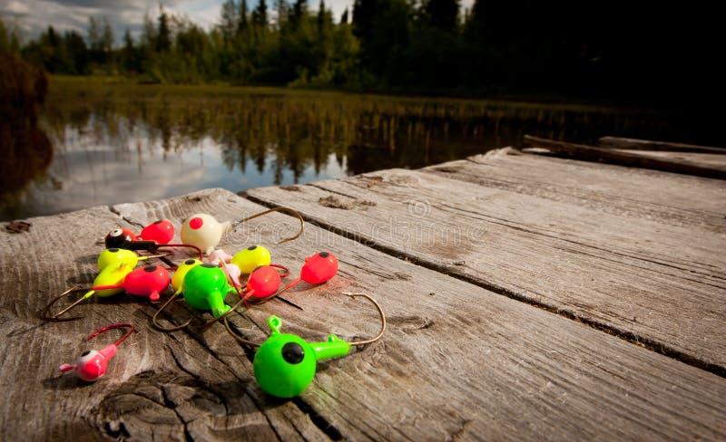Pesca dei richiami sul bacino fotografie stock