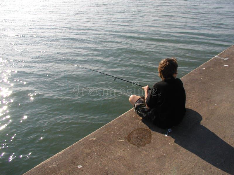 Download Pesca del muchacho foto de archivo. Imagen de lago, pesca - 186774