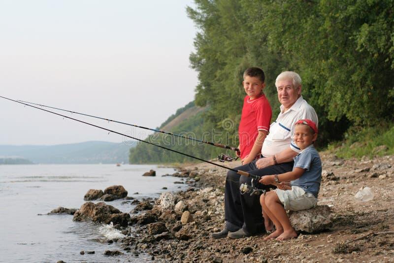 Pesca della famiglia fotografia stock