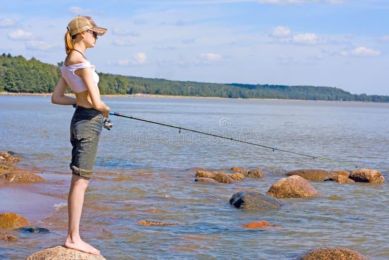 Pesca della ragazza fotografie stock