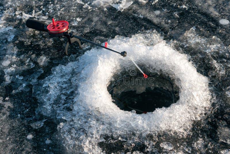 Pesca di inverno immagini stock