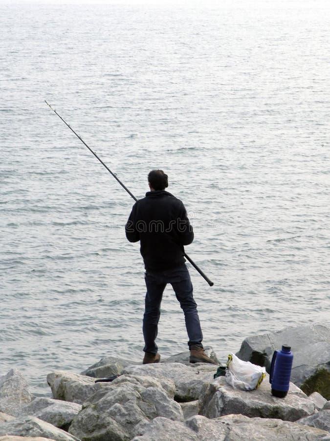 Download Pesca do homem foto de stock. Imagem de haste, calmo, recreação - 101338