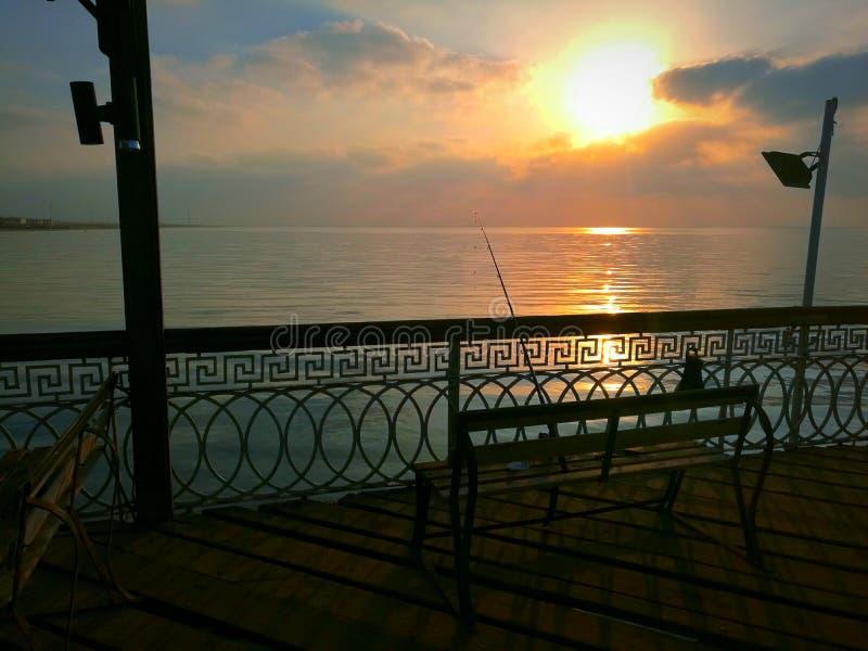 Pesca en la salida del sol ¤ del  del â foto de archivo